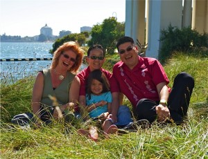 From left to right, Maya and MeiBeck Scott-Chung with their daughter Luna, and Daniel Bao. Bao donated his sperm to help Maya and MeiBeck conceive.  (Photo: Vaschelle Andre)