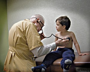 This 2009 photo shows the 83-year-old doctor examining the photographers's son. (Laura4Smith:Flickr)