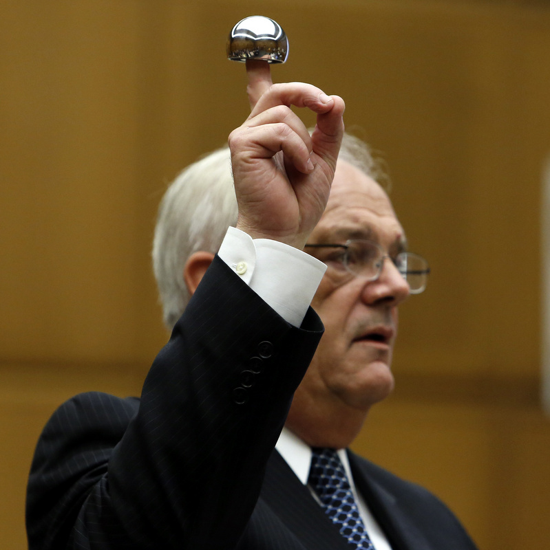 Michael Kelly, attorney for plaintiff Loren Kransky, holds up an ASR XL hip implant made by Johnson & Johnson during his opening statement to the jury at the trial of Kransky v. DePuy, at California Superior Court in Los Angeles, on Friday, Jan. 25, 2013. (Credit: Patrick T. Fallon/Bloomberg)