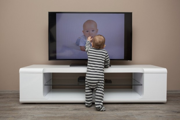 It's easy to imagine how this baby could be hurt if the TV toppled over. (Getty Images)