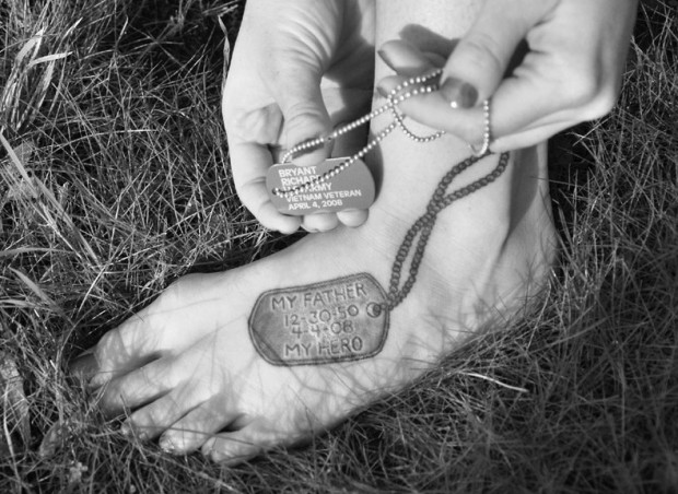 A commemorative Army dog tag similar to the one worn by Caitlin's father, was designed by her aunt and passed out at Richard Bryants' funeral service. Caitlin recently had a tattoo artist replicate one on her foot. (Photo by: Margarita Brichkova)