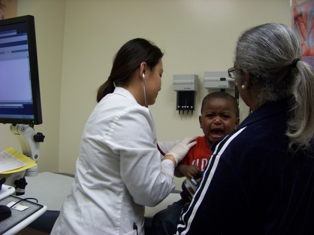 Pediatric Nurse Practitioner examines toddler. (Chris Richard/KQED)