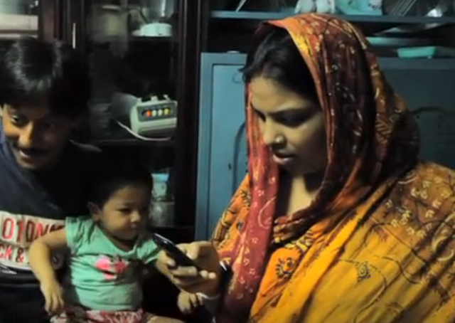 This woman in Bangladesh receives educational text messages about baby care. (Scene from MAMA Global video)