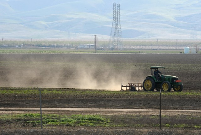 Fungal spores that cause valley fever are carried in the dust. Activities including farming in the Central Valley contribute to the spread of the spores. (Robin Beck/Getty Images)