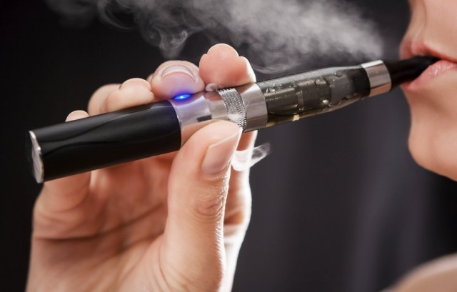 Woman using an e-cigarette. (Getty Images)