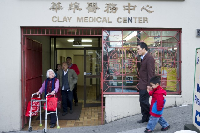 "CCHP's motto, ""caring for generations,"" in action at the entrance to Dr. Gustin Ho's medical practice in Chinatown. (Marcus Teply/KQED)"