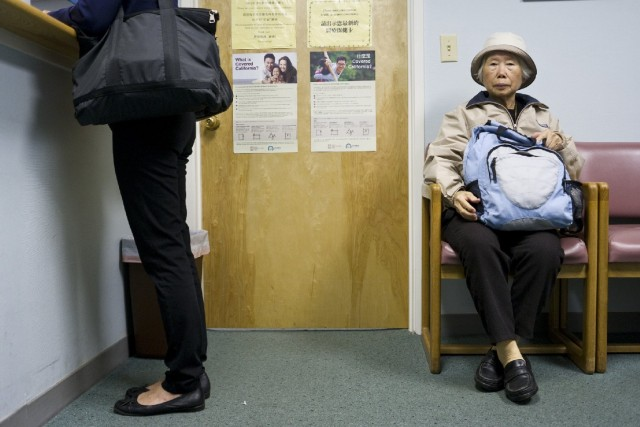 "A woman waits to see Dr. Gustin Ho at his office in San Francisco's Chinatown. Ho says 99 percent of his current patients are ethnically Chinese, but that for CCHP, ""diversity is the way to go."" (Marcus Teply/KQED)"