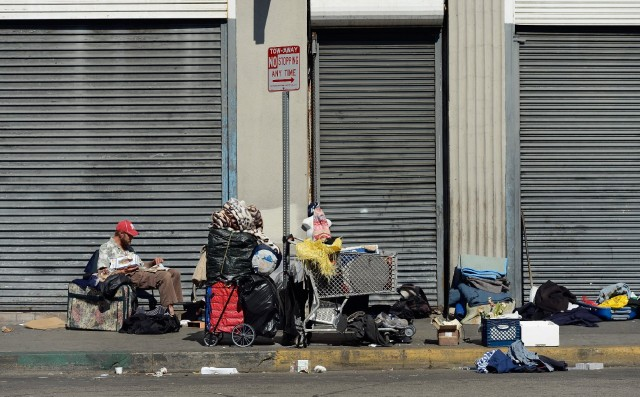Man sits in Skid Row area of Los Angeles. Advocates say homeless people tend to have complex health problems. (Kevork Djansezian/Getty Images)