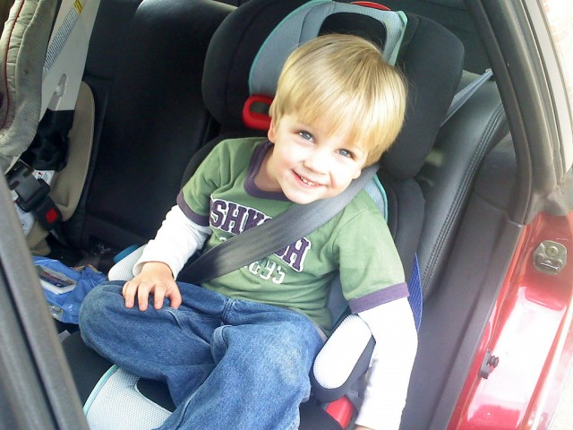 Children should always use a booster seat until they are big enough to fit in a seat belt properly. (Joshua & Amber/Flickr)