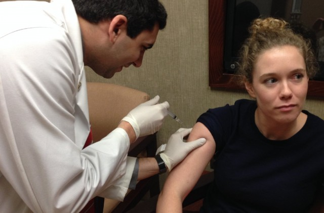 KQED News interactive producer Olivia Hubert-Allen gets her flu shot. (Lisa Pickoff-White/KQED)