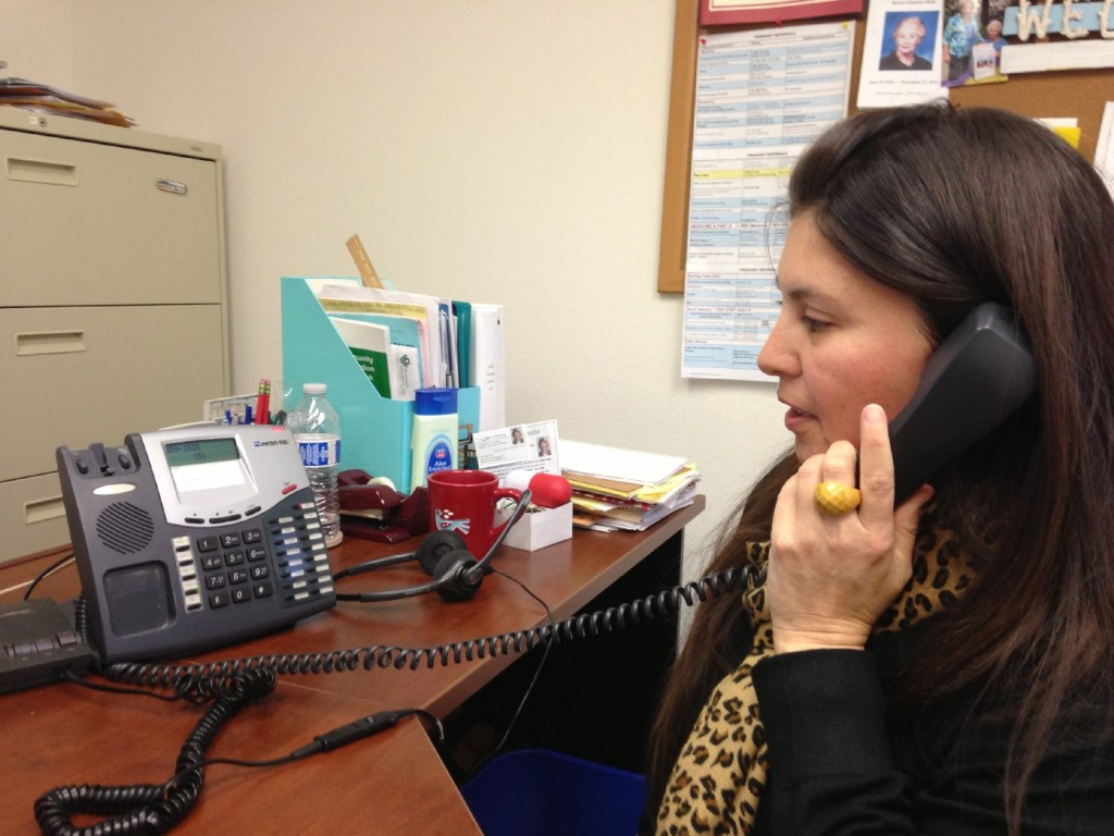 Christina Kahn, manager of the San Mateo Health Insurance Counseling and Advocacy Program, returns phone calls to local seniors.