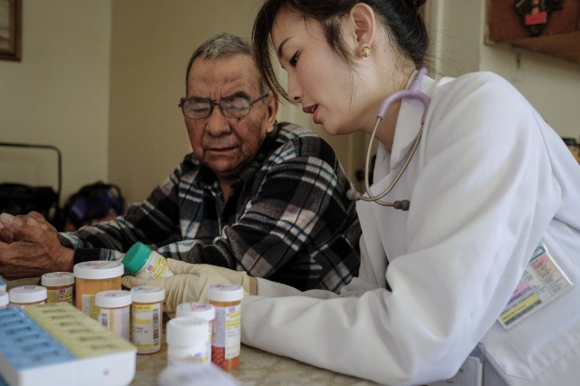 Dr. Sarah Ma goes over medications and dosages with diabetes patient Joe Navarro. (Credit: Anacleto Rapping)