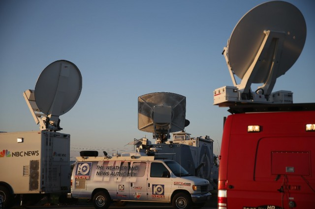 Television news live trucks at the front gate of Fort Hood, Texas. (Joe Raedle/Getty Images)