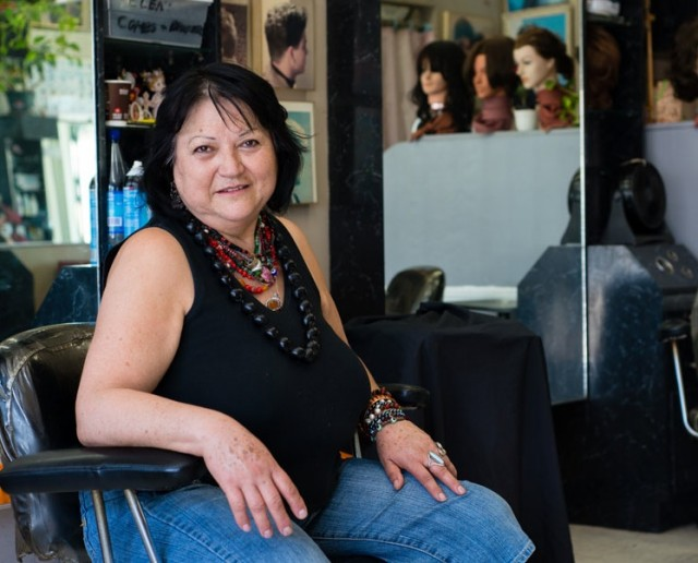 Teresa Martinez, 62, works as a hairdresser at a Koreatown hair salon. She earns about $10,000 per year and cannot afford to buy private health coverage (Photo by Heidi de Marco/KHN).