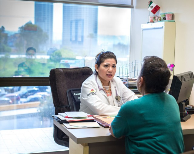 Dr. Cecilia Espinoza meets with her patient Irma Montalvo. Montalvo, a U.S. citizen, prefers to travel to Mexico for health care, even though she signed up for a health plan through Covered California (Heidi de Marco/KHN).