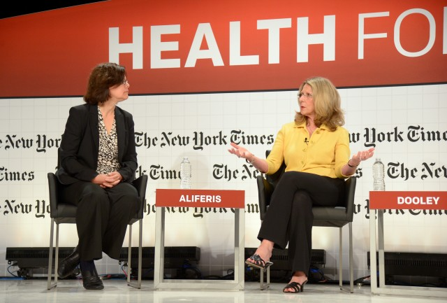 Diana Dooley (right), Secretary of California's Health and Human Services Agency, talks with KQED's Lisa Aliferis about the Affordable Care Act at a New York Times conference at UCSF. (Michael Loccisano/Getty Images for New York Times)