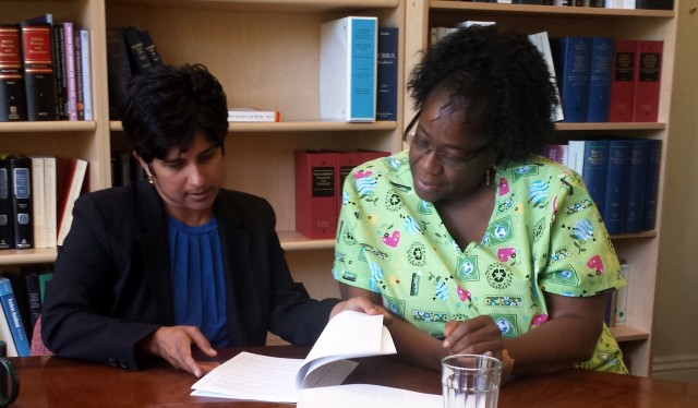 Plaintiff Ginger Rogers with one of her attorneys, Hina Shaw, reviewing the complaint that was filed today against Kindred Healthcare and affiliates. (Photo: Sara Feldman)