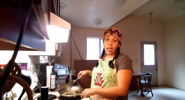Meagan Baldy demonstrates a stir-fry of local salmon, kale and mushrooms. (screen grab from YouTube)