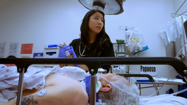 "Dr. Jamie Eng with patient in the documentary ""Code Black."""