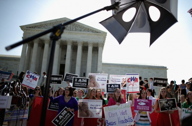 Anti-abortion advocates rally in front of the Supreme Court awaiting the decision in Burwell v. Hobby Lobby Stores was announced Monday. (Chip Somodevilla/Getty Images)
