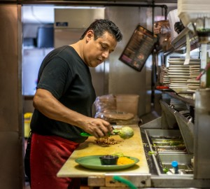 Jorge Castaneda, a cook at Lopez's restaurant has been uninsured most of his adult life. The 47-year-old says he hardly gets sick, but is waiting for his employer to offer health insurance (Heidi de Marco/Kaiser Health News).
