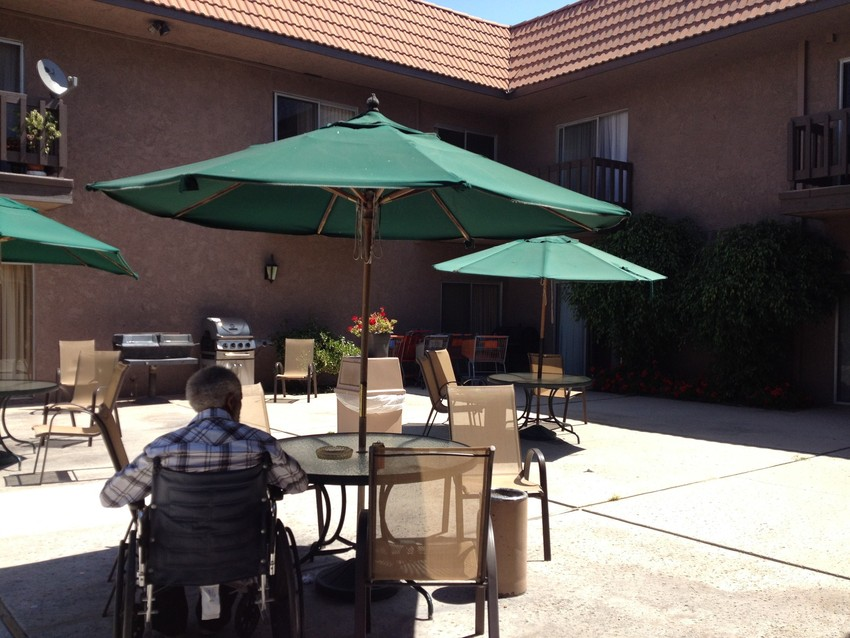 Taking some fresh air in the courtyard at Westchester Villa, an assisted facility in Inglewood. (Rachael Myrow/KQED)