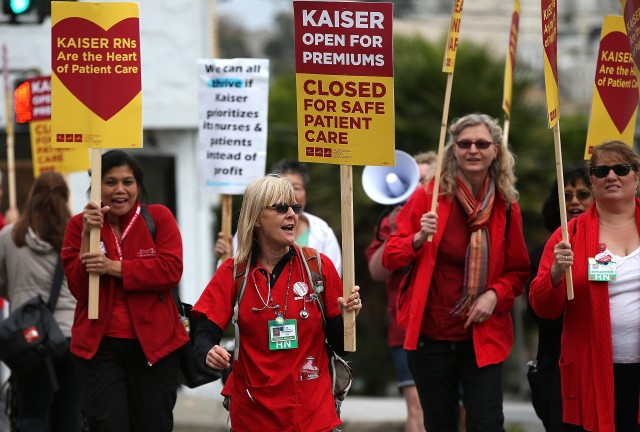 Nurses carry signs as they strike outside of Kaiser Permanente hospital in San Francisco last week. (Justin Sullivan/Getty Images)