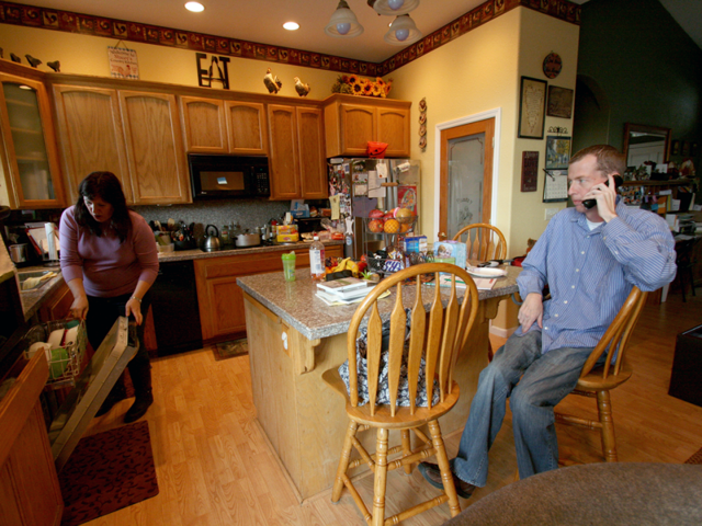 Stacey and Kory Felker in their Quincy, California home. The Felkers live near the California-Nevada border, and recently learned that their individual insurance does not cover routine out-of-state care. (Pauline Bartolone/Capital Public Radio)
