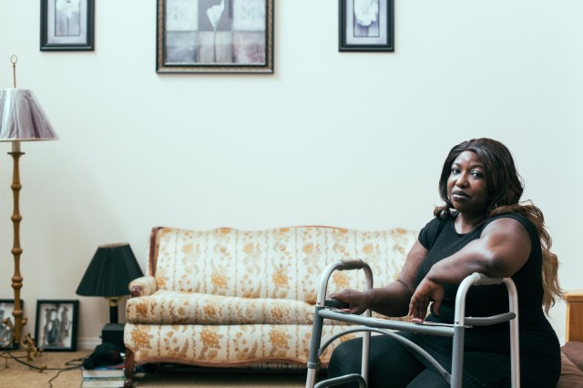 Derika Moses, a former softball star, lost her job, and then her home, as she grappled with pain and illness after her spinal surgery. (Annie Tritt/CIR)