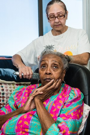 Maggie Belton suffers from arthritis and diabetes. The 82-year-old gets in-home care from Armida Pineda, 64, at her Pasadena apartment. (Heidi de Marco/KHN)