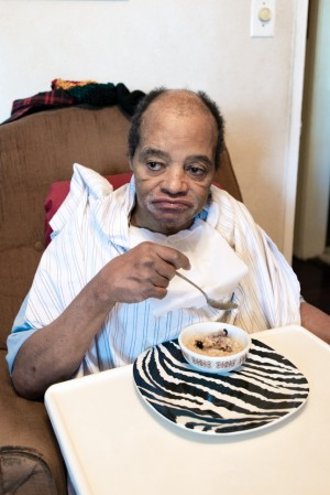 Charles Massengale can eat by himself, but needs help with everything else. The former tree trimmer has severe brain damage from a 30-foot fall, as well as dementia, diabetes and high blood pressure (Heidi de Marco/KHN).