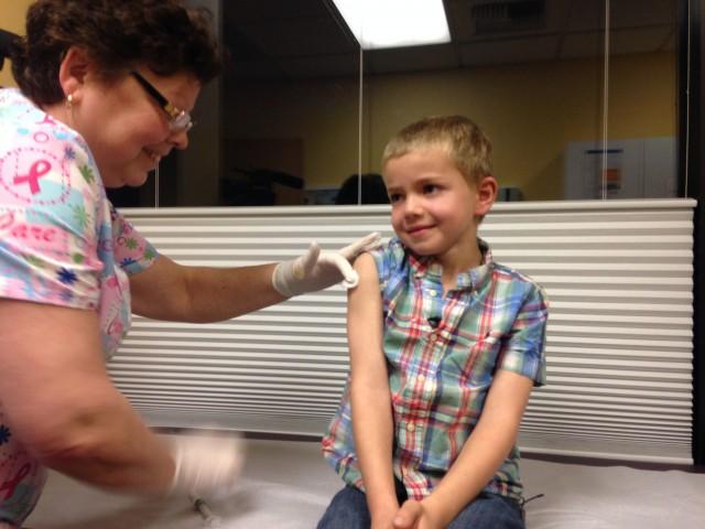 Rhett Krawitt, of Corte Madera, received the measles, mumps, rubella vaccine on Friday. (Lisa Aliferis/KQED)