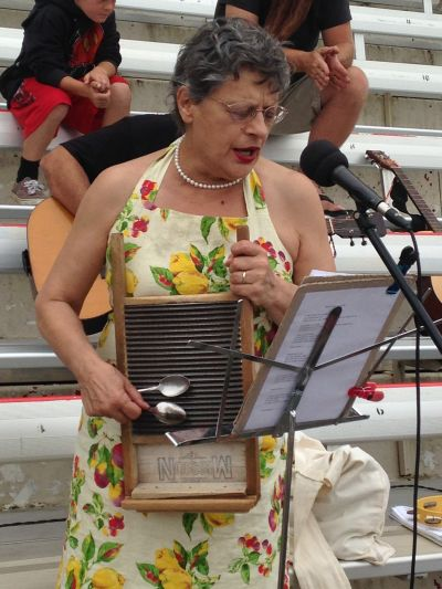 Sophie Lauterborn. a Valley Fire evacuees, play washboard with other musicians a the Napa County Fairgrounds evacuation center in Calistoga.