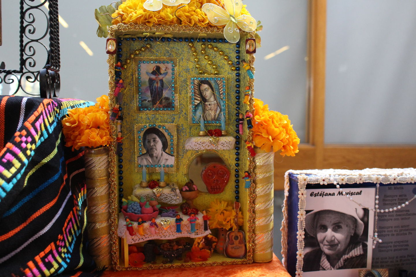 Nichos decorate an altar at the Oakland Museum of California for Day of the Dead. The central inch was made by art therapist Alicia Diaz to honor her grandmother. Diaz says was very religious and loved the color yellow. Farida Jhabvala Romero /KQED