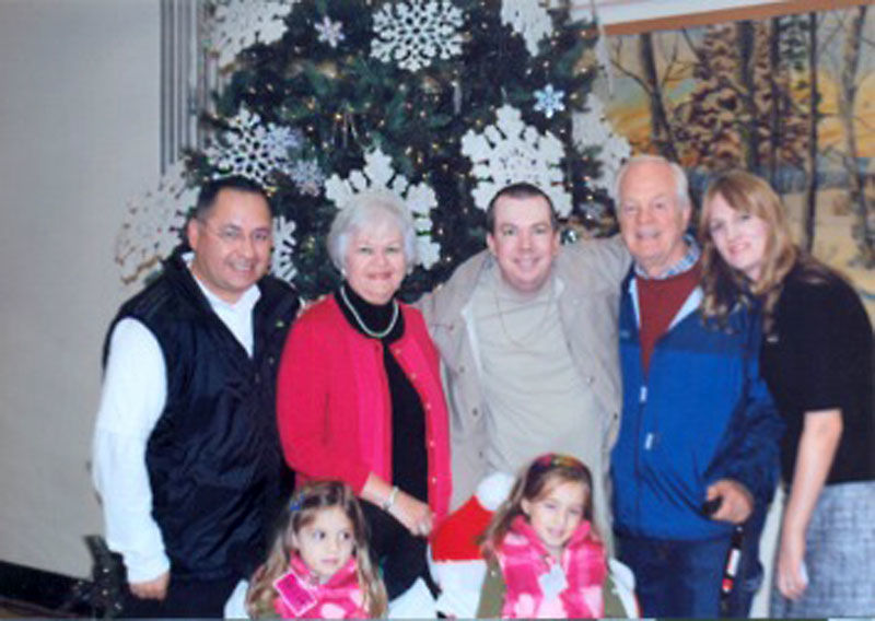 Shawn Brackin (top middle) celebrating Christmas with his family at Napa State Hospital in December, 2011.