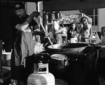 James stirs a vat of kettle corn at the Watsonville Farmer's Market.