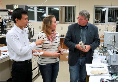 Research professor Wenjie Liu works with graduate student Jennifer Tufariello and professor Herb Hill to develop a marijuana breath testat Washington State University
