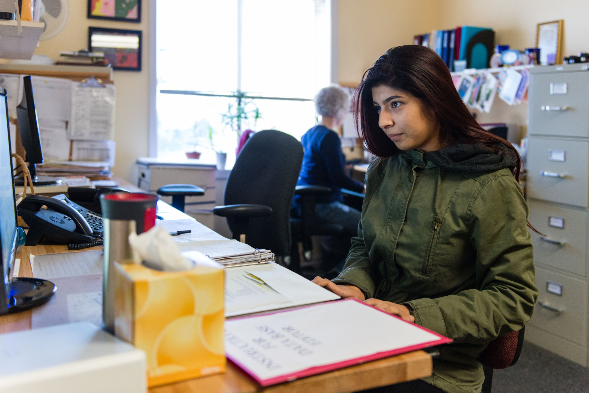 Nubia Flores Miranda, 18, works part-time at Family Paths, a counseling and mental health organization in Oakland. Miranda said she became interested in a career in mental health after she started experiencing depression and anxiety her freshman year at Life Academy of Health and Bioscience.