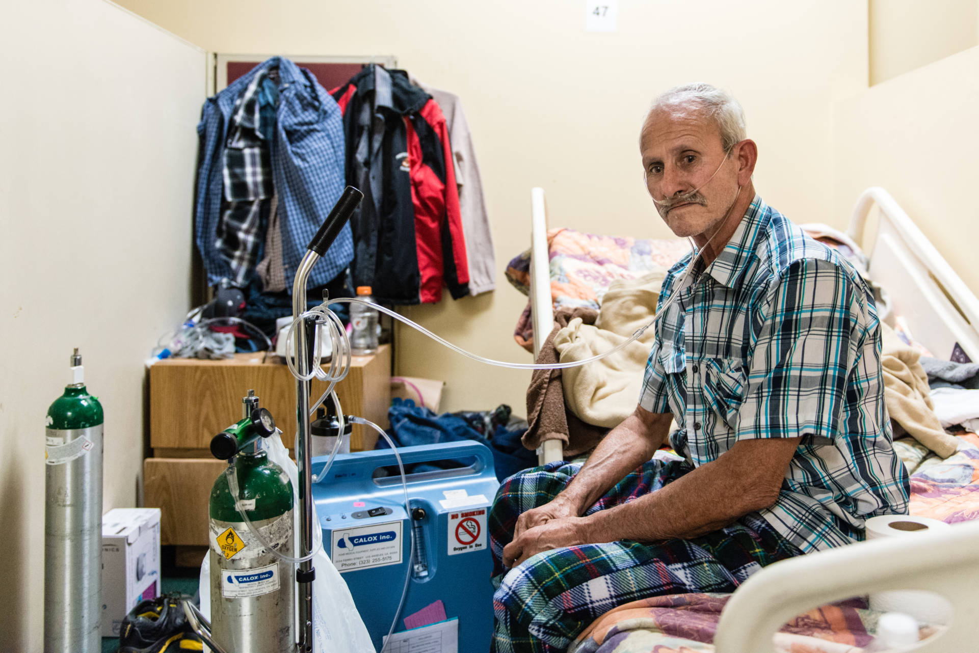 Victor Ramirez, 61, uses his ventilator at the men's dorm at the Illumination Foundation Recuperative Care in Santa Fe Springs, Calif.