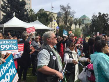 Nurses and health care activists rally at the Capitol to push for universal health coverage in California.