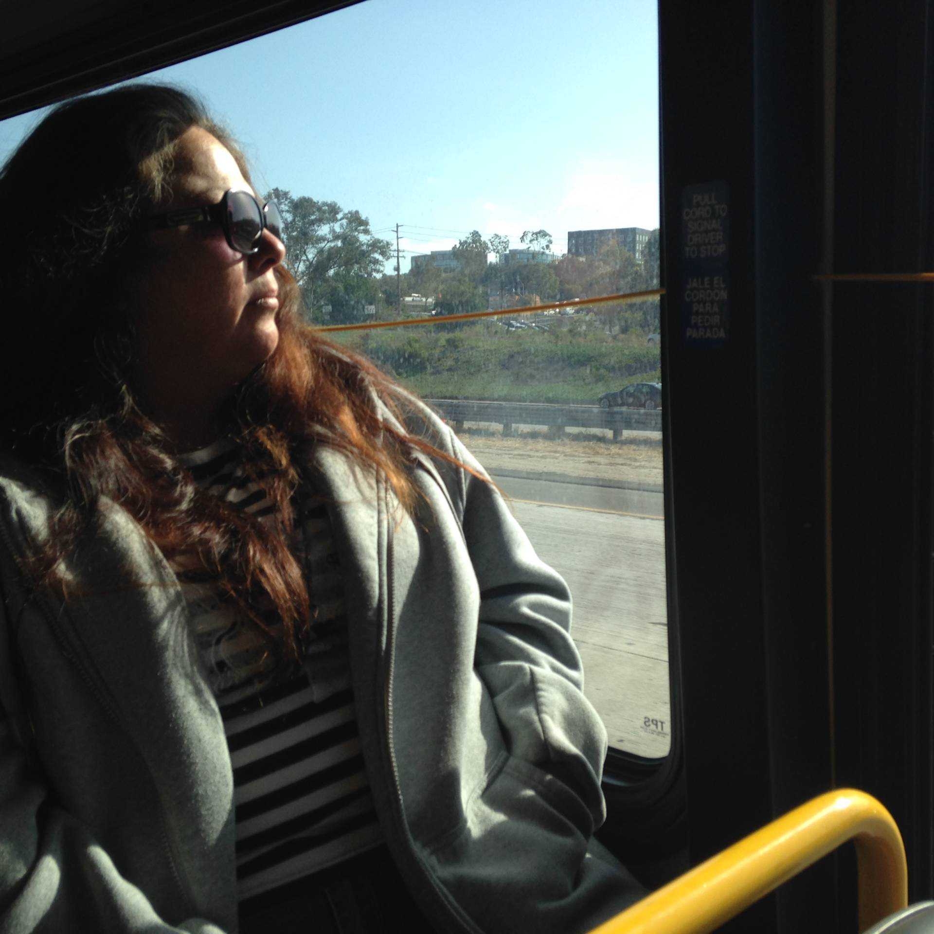 Maria Spivey, riding a bus in San Diego. She's on leave from her job as a driver.
