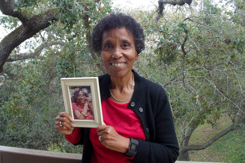 Andrea Gourdine holds a photo of her mother, Gladys Brown, who died in 2012 after being diagnosed with Alzheimer's. Brown donated her brain to the University of California-Davis, for research.