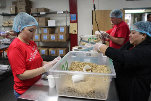 A team of volunteers from Wells Fargo pack healthy ingredients at Project Open Hand in San Francisco on July 6.