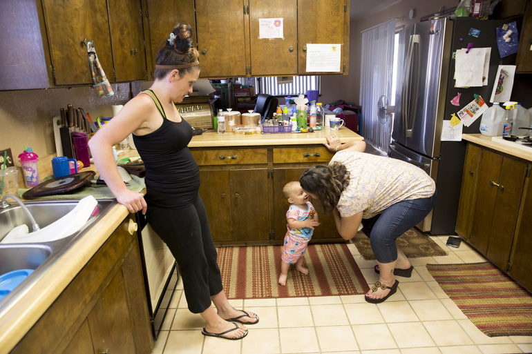 After Heather Menzel takes her methadone prescription on a summer morning in 2016, she goes into the kitchen and watches her daughter, Bella, play with Menzel's mother, Tawanna Maxwell-Cecil, at their home in Lake Isabella, Calif.