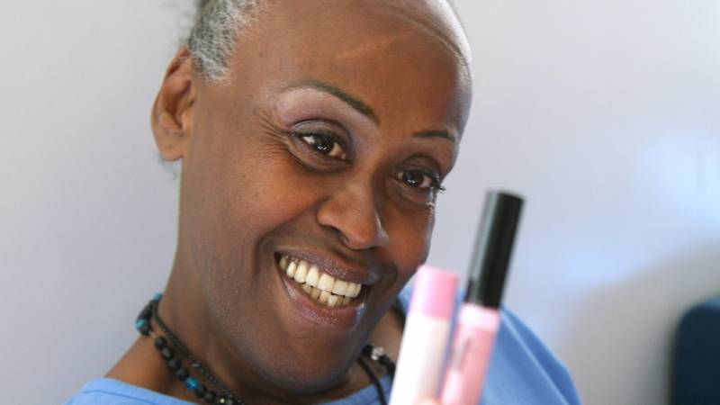Cary CJay Smith shows her makeup in her favorite color: pink. The state prison system in 2015 started allowing access to apparel previously reserved for female prisoners at women's prisons — items like bras, clothing, makeup and jewelry. Similar policies were put into place for transgender men at women's prisons.