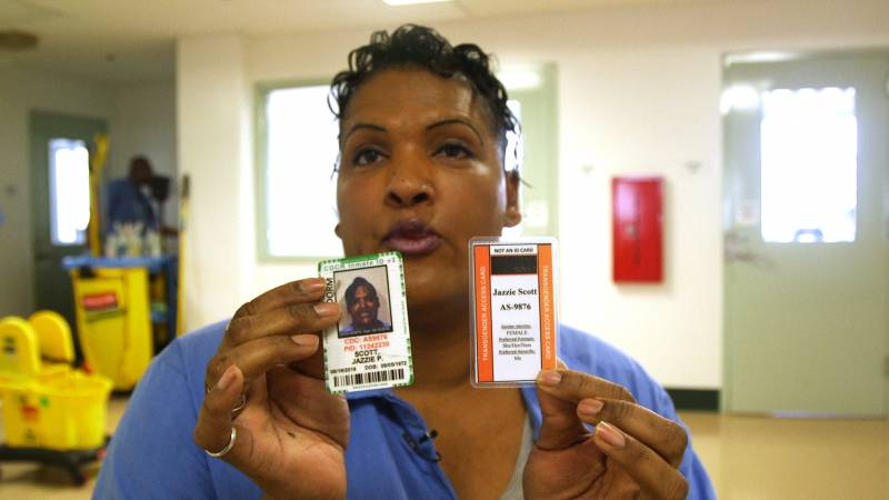 Jazzie Paradize Scott displays her transgender ID card, issued by the California Department of Corrections and Rehabilitation. The CDCR has designated certain prisons as hubs for transgender inmates, where support services and resources can be clustered.