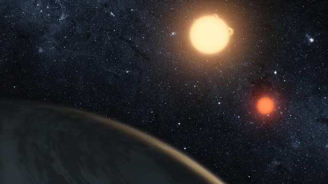 This artist's concept depicts a small planetary system around a red dwarf. Credit: NASA Ames