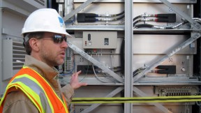 PG&E's Dave Fribush shows the interior of their 4MW battery storage project in San Jose. (Photo: PG&E)
