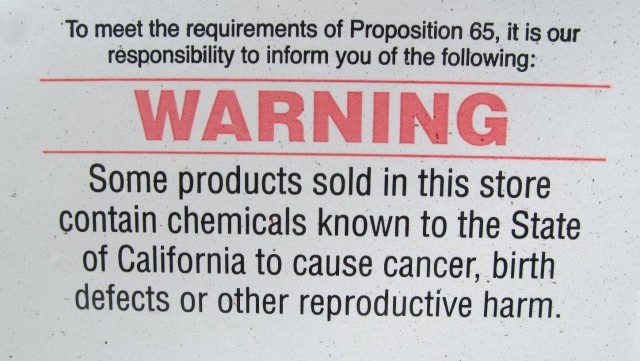 Prop. 65 warning posted outside of a San Francisco auto parts store. (Mike Osborne/KQED)