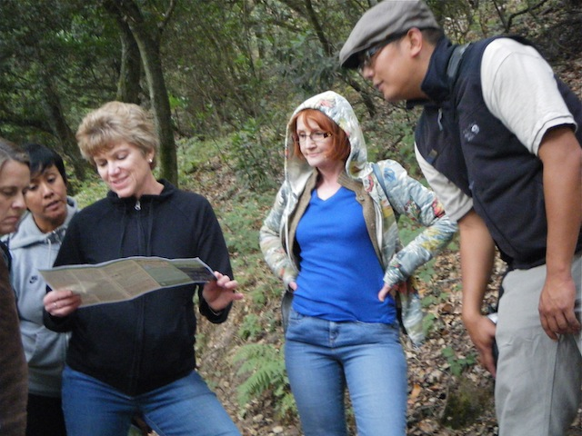Naturalist Francis Mendoza consults with hikers on the Tuesday Twilight program at Huckleberry Botanic Preserve.